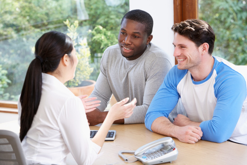Male Couple Talking With Financial Advisor Stock Photo - Download Image Now