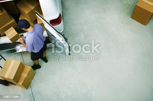 istock Male Courier Delivery Packages 108271094