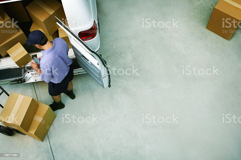 Male Courier Delivery Packages stock photo