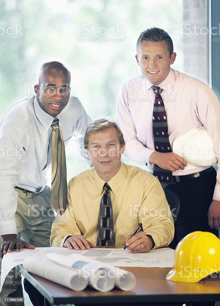 Male Co-workers Smiling In the Office royalty-free stock photo