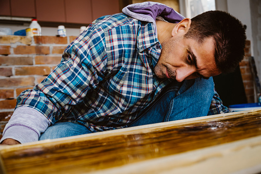 530997702 istock photo Male craftsman makes a wooden table 1129483727