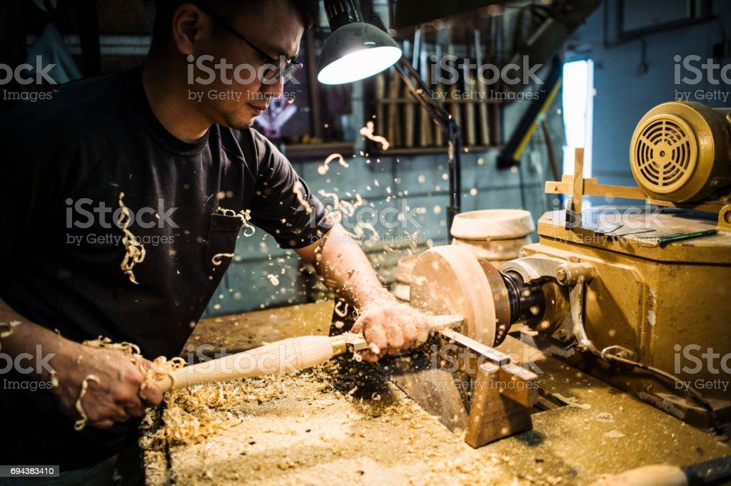 Male craftsperson working in studio stock photo