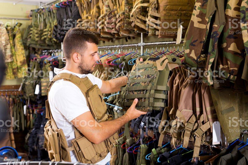 Male customer choose bulletproof vest stock photo