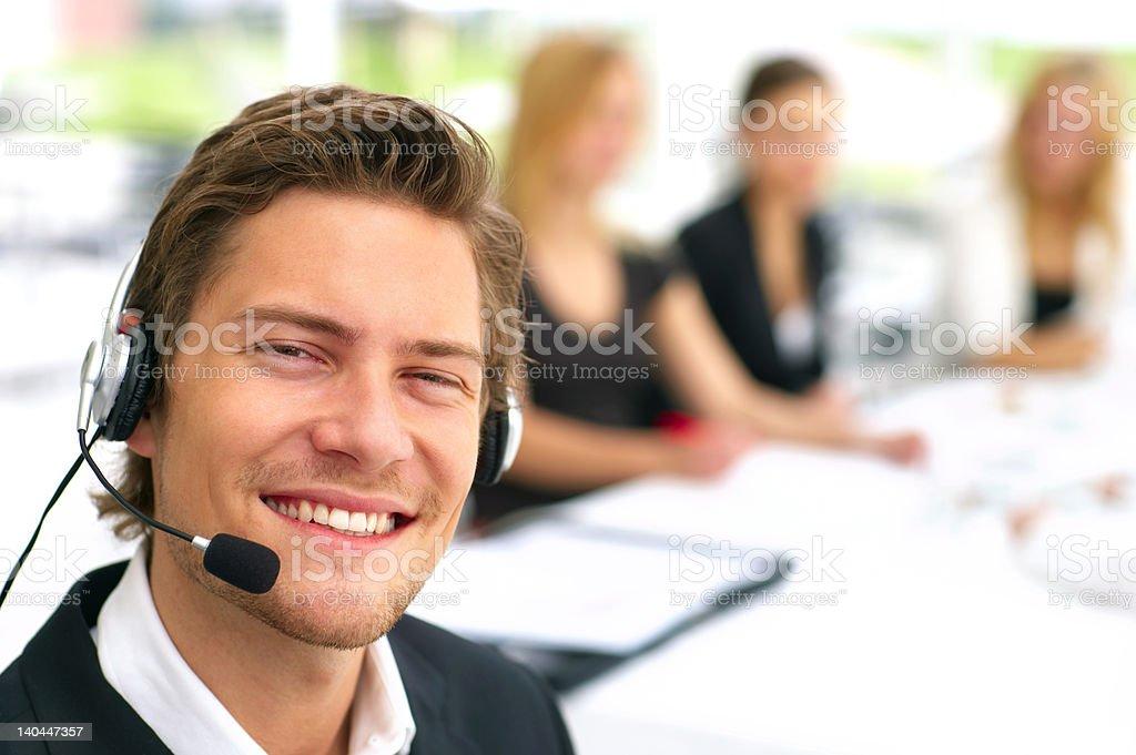 Male customer service representative smiling royalty-free stock photo