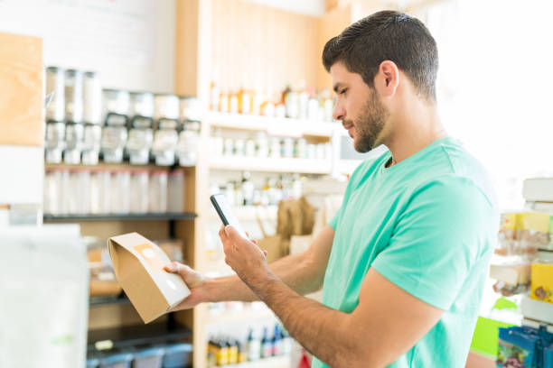 Male Customer Shopping In Supermarket stock photo