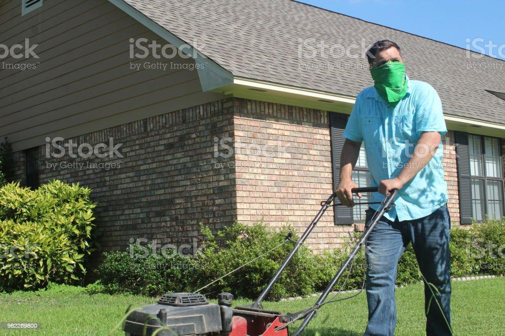 Male Cuts Lawn - Alergy stock photo