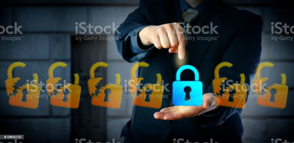 Male Cyber Security Manager Selecting Closed Lock stock photo