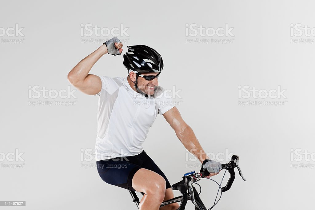 Male cyclist cheering stock photo