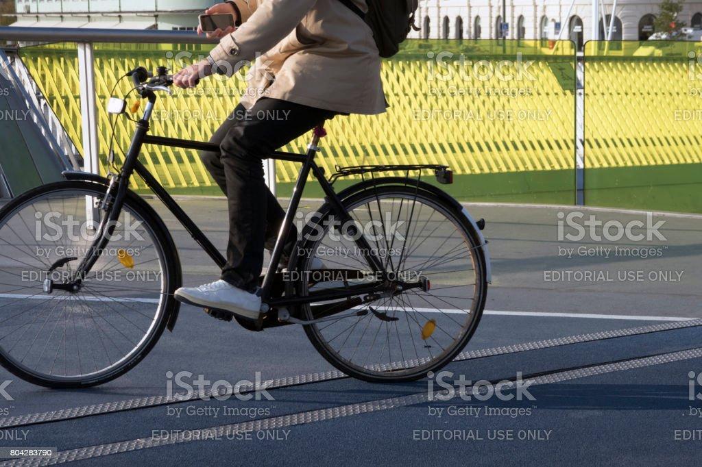 Male cyclist on new bridge stock photo