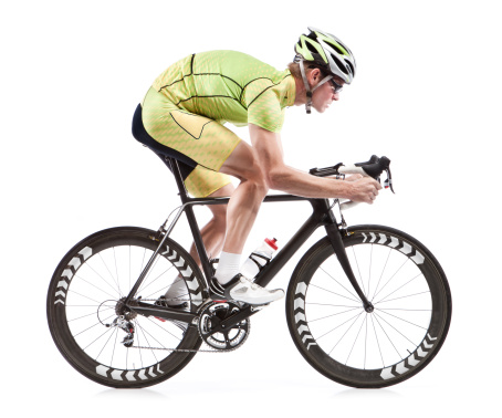 A young man is dressed in cyclist attire, and he is riding a modern road bicycle with black-and-white tires.  The image is set on a pure white background.