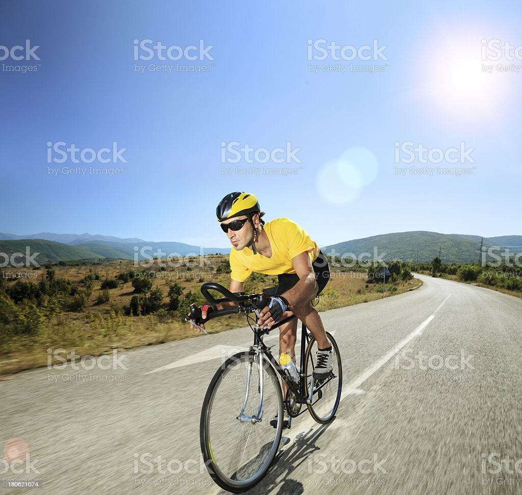 Male cyclist riding a bike on sunny day royalty-free stock photo