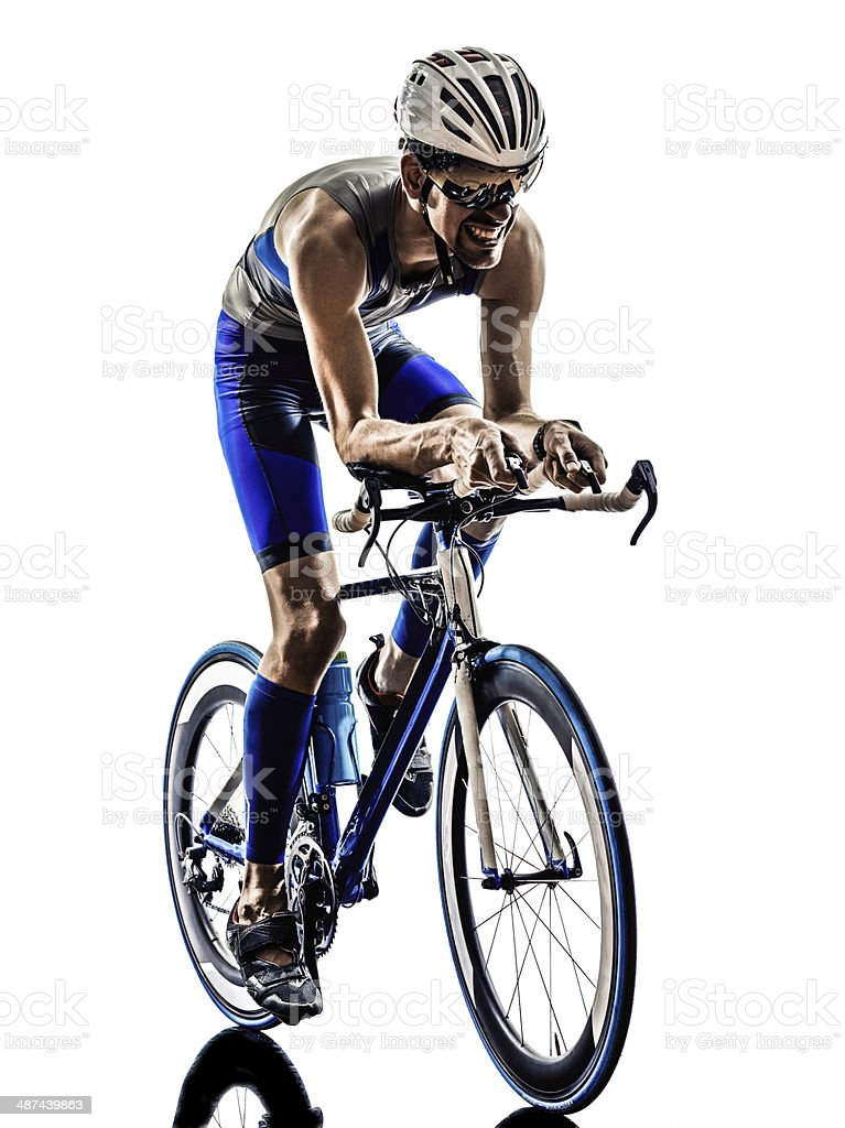 Male cyclist riding bike against white background stock photo
