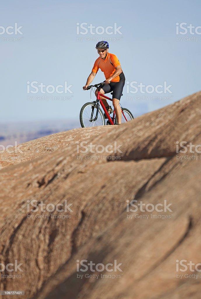 Male Cyclist Riding Mountain Bike on Slick Rock Trail royalty-free stock photo