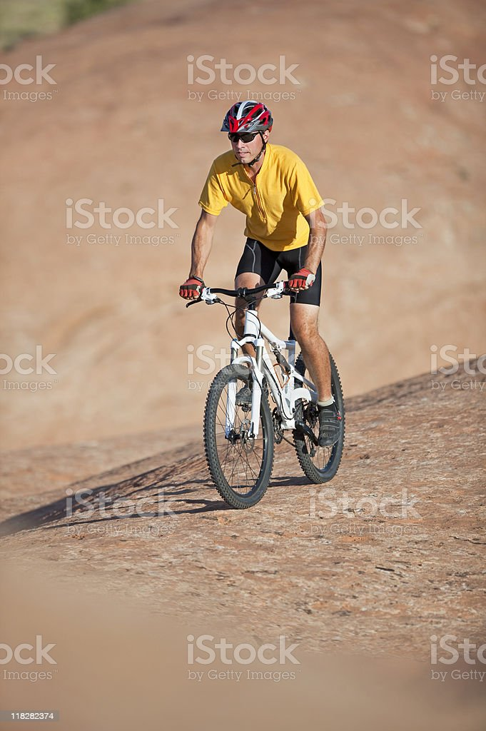 Male Cyclist Riding Mountain Bike On Slickrock Trail, Moab, Utah royalty-free stock photo