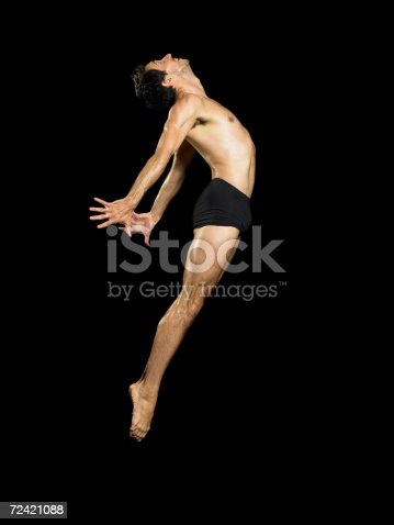 istock Male dancer jumping 72421088