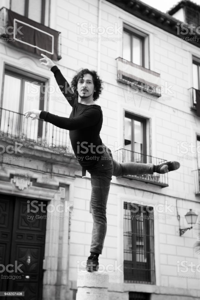 Male dancer performing pirouette. Urban background stock photo