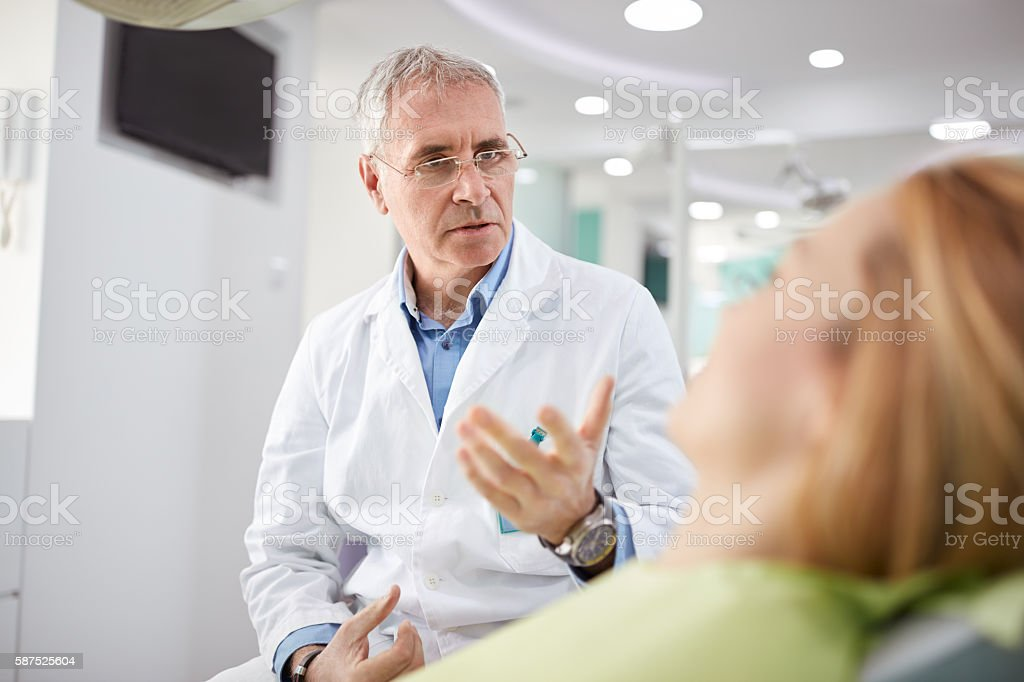 Male dentist on working place in dental practice stock photo