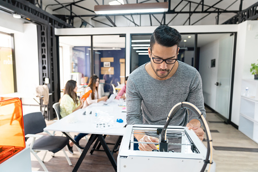 istock Male designer using a 3D printer 1021334632