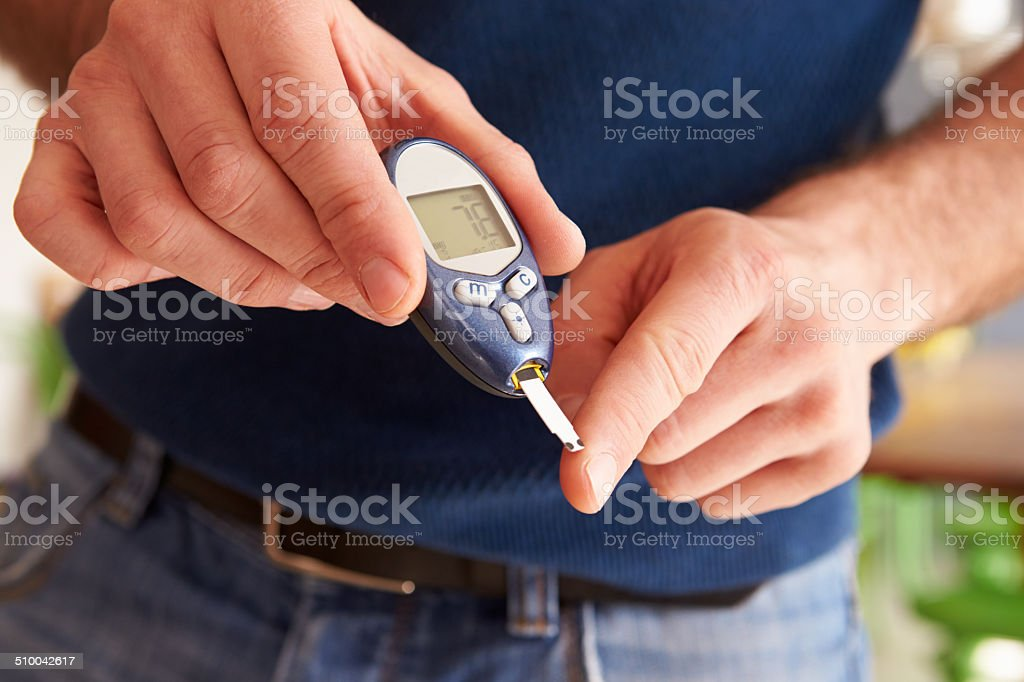 Male Diabetic Checking Blood Sugar Levels Male Diabetic Checking Blood Sugar Levels 30-39 Years Stock Photo
