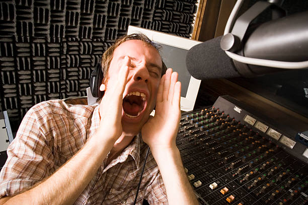male dj shouting out to the world - radio dj stock photos and pictures
