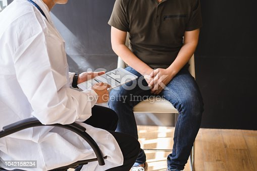 istock Male doctor and testicular cancer patient are discussing about testicular cancer test report. Testicular cancer and prostate cancer concept. 1042158234
