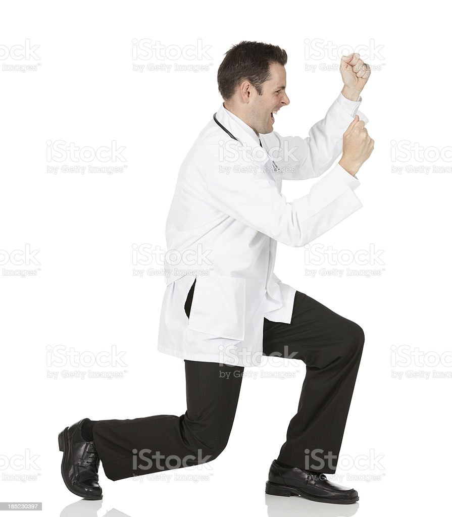 Male doctor celebrating his success stock photo