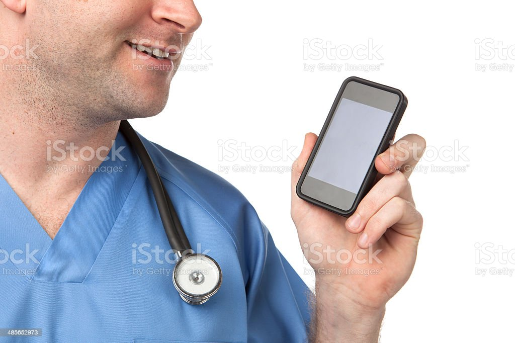 Male Doctor dictating into smart phone stock photo
