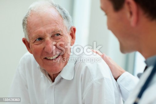 istock Male doctor discussing with his patient 133428363