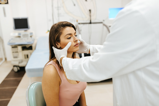 Male doctor examined female patient