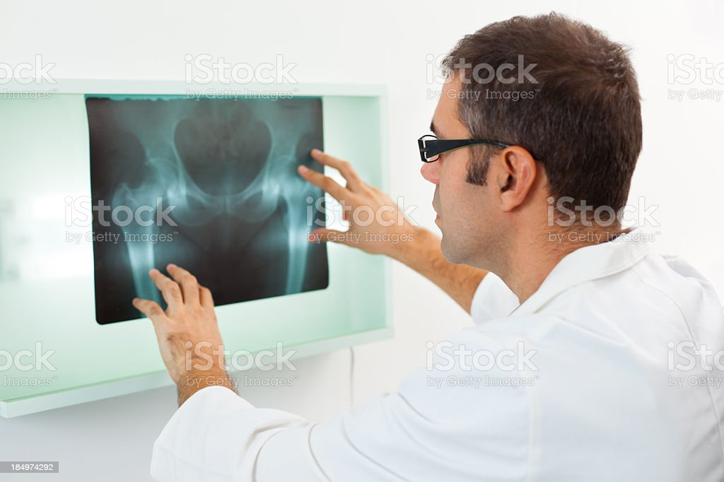 Male doctor examining X-ray image stock photo