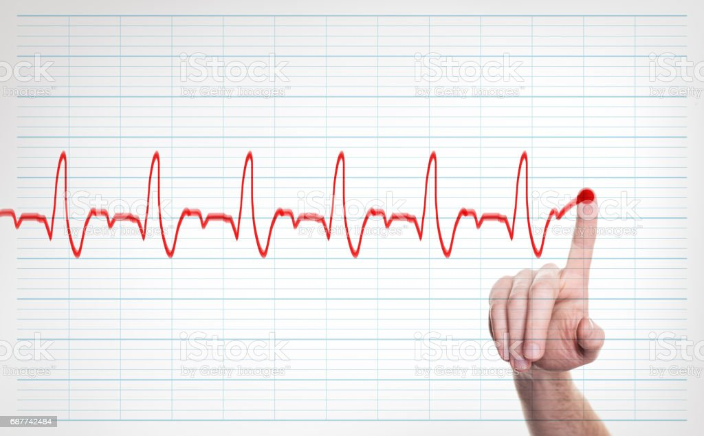 Male Doctor Hand Writing Virtual Cardiogram over Background stock photo