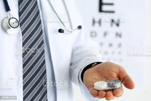 Male doctor hands giving pair of contact lens picture id526847242?b=1&k=6&m=526847242&s=612x612&h=v1v6aill8pmpdritdgcnxrzep6au4jyfdv8 pvcajse=