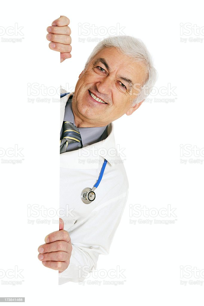 Male doctor holding a blank sign (on white) royalty-free stock photo