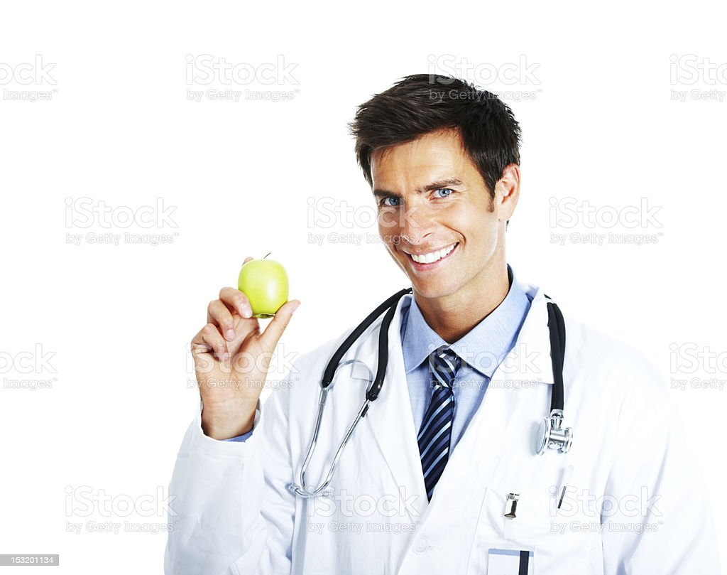 Male doctor holding an apple and smiling royalty-free stock photo