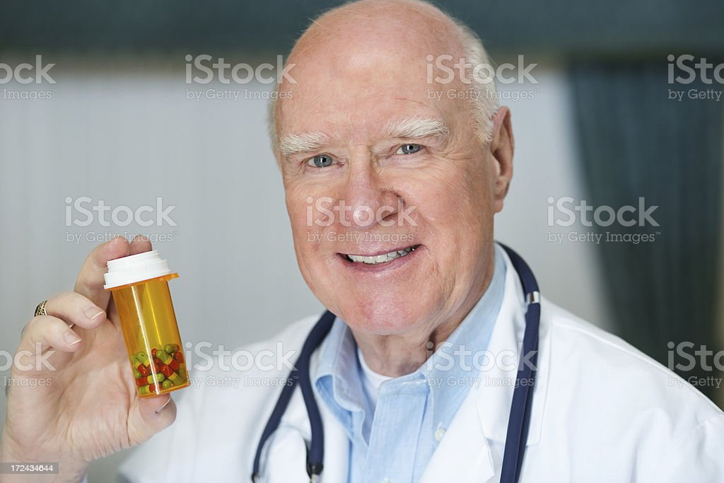 Male Doctor Holding Pill Bottle royalty-free stock photo
