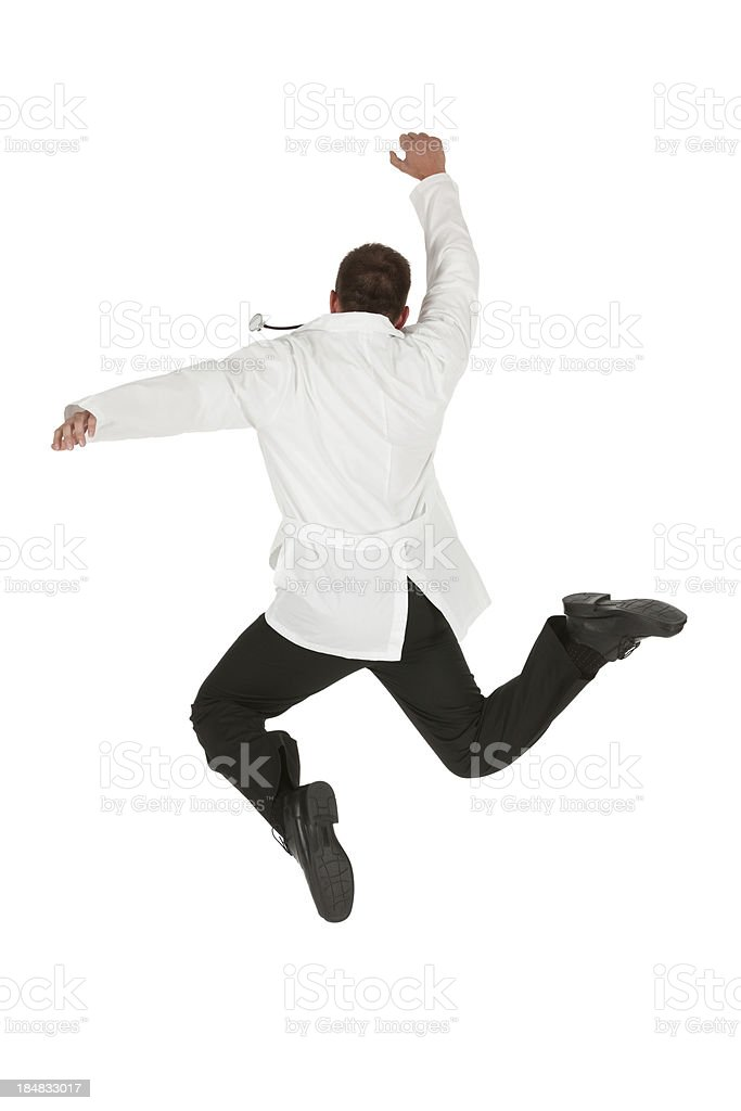 Male doctor jumping stock photo