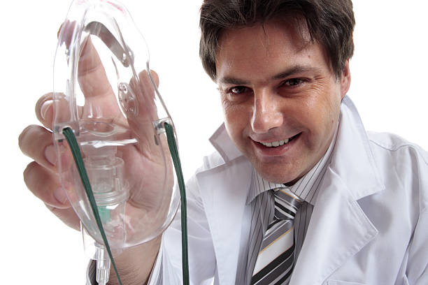 Male doctor or anesthetist  nitrous oxide stock pictures, royalty-free photos & images