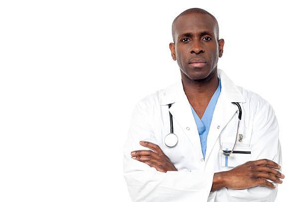 Male doctor posing  with arms crossed stock photo