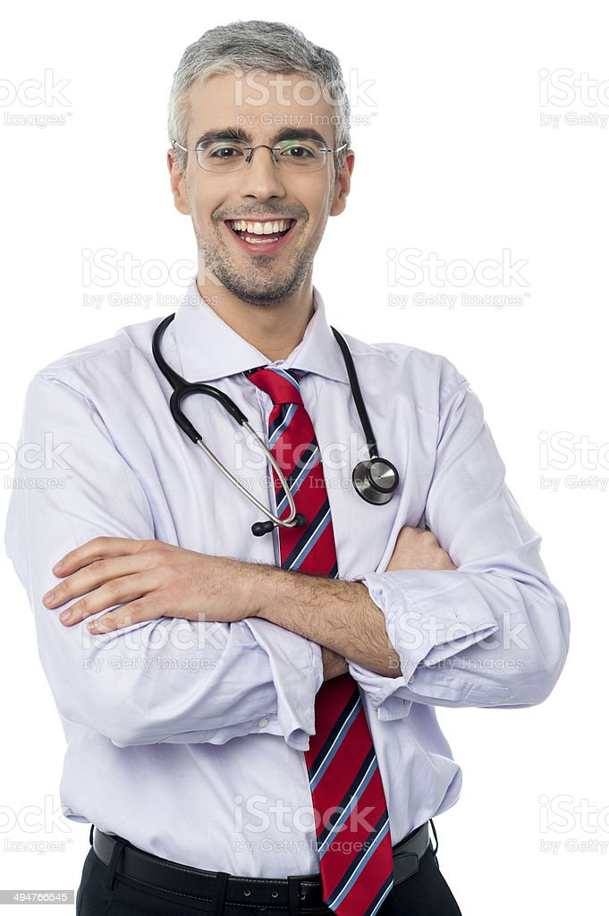 Male doctor smiling with arms crossed royalty-free stock photo