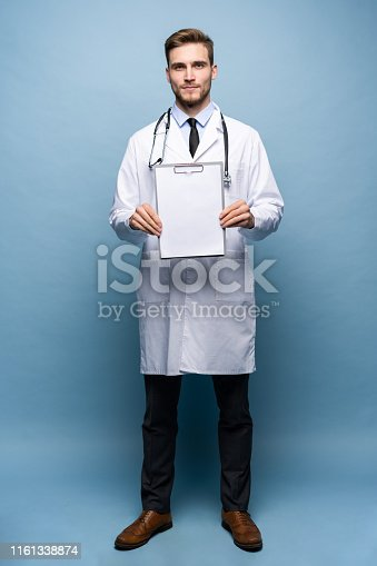 Male Doctor standing with folder, Doc is wearing white uniform and a tie, stands on a light blue background