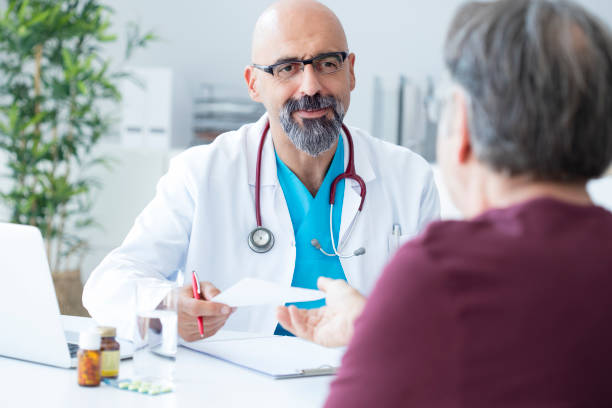 Male doctor talking to patient stock photo