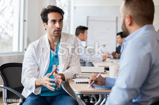 istock Male doctor talks with hospital administrator 1149286405
