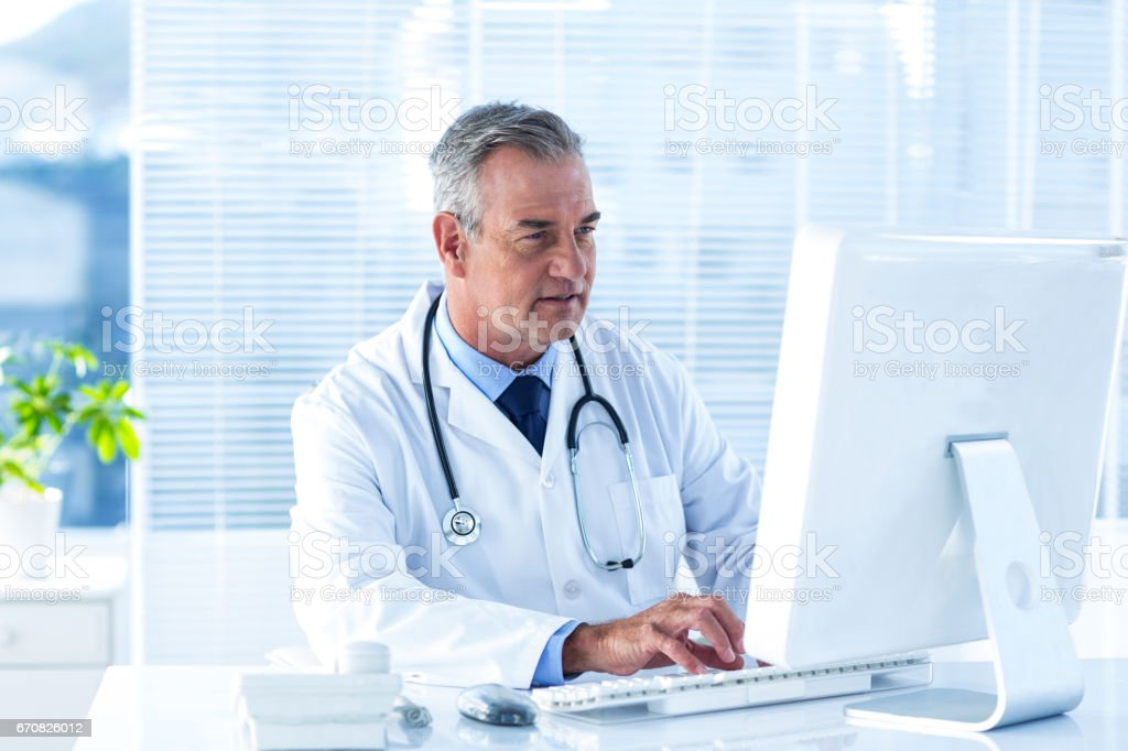 Male doctor using computer in hospital stock photo