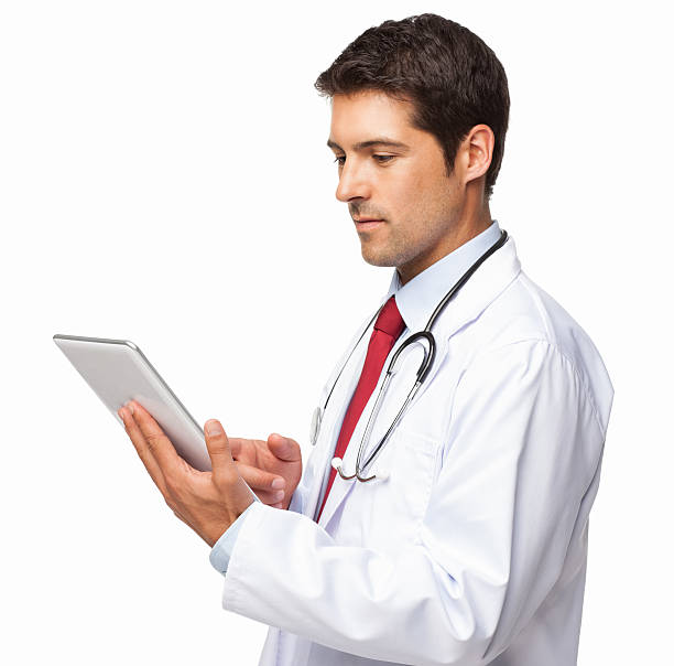 Male Doctor Using Digital Tablet - Isolated stock photo