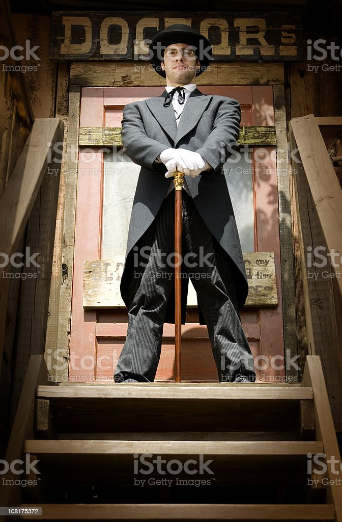 Male Doctor Wearing Period Costume Suit in Wild West royalty-free stock photo