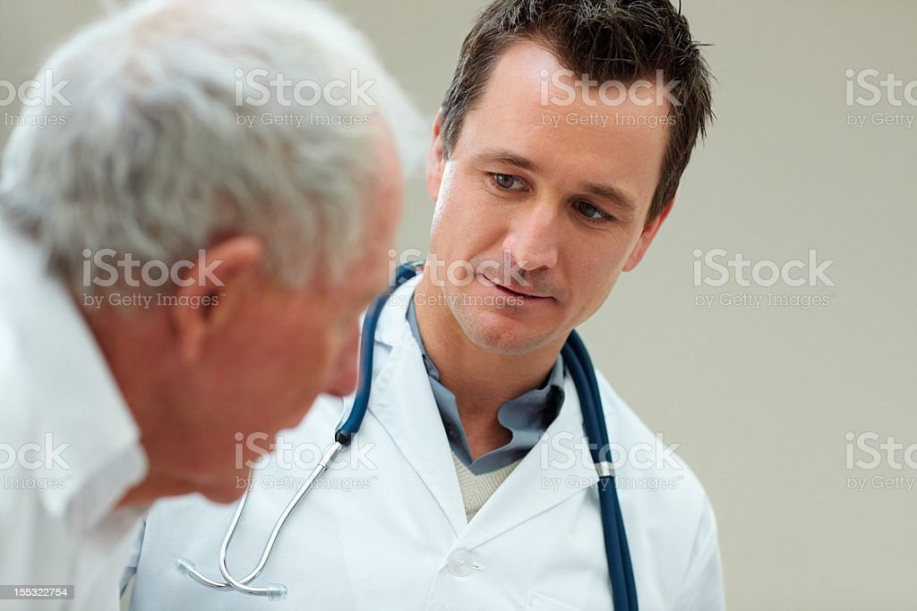 Male doctor with his patient royalty-free stock photo