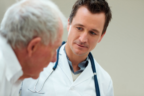 Male Doctor With His Patient Stock Photo - Download Image Now