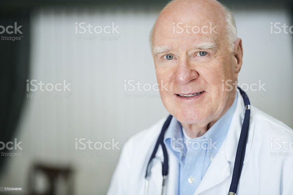 Male Doctor With Stethoscope Around Neck In Clinic royalty-free stock photo