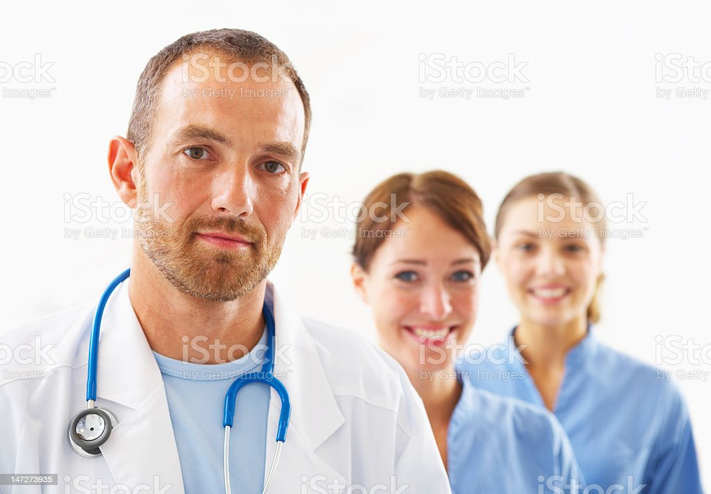Male doctor with two smiling female nurses royalty-free stock photo