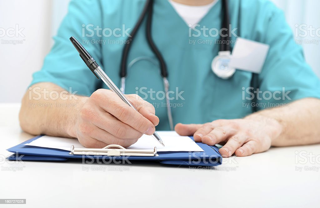 Male doctor writes a medical history royalty-free stock photo